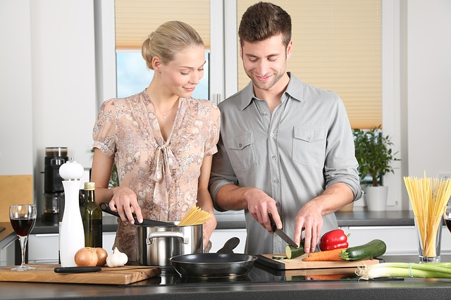 a couple cooking a healthy dinner together