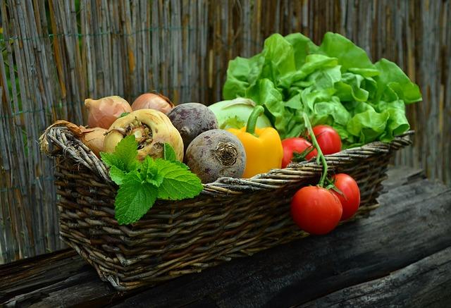 a basket of garden vegetables
