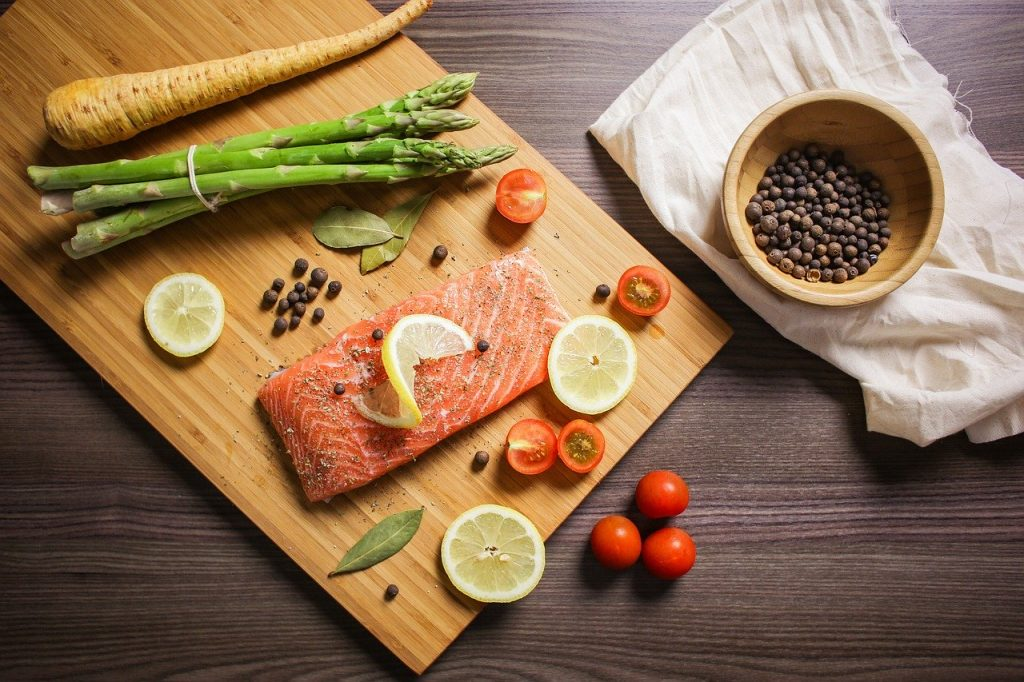 salmon red quinoa on asparagus with lime cilantro sauce