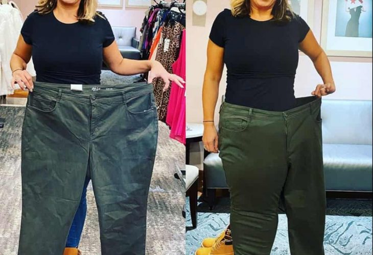 a woman share her success with the optavia diet program by holding an old pair of her pants