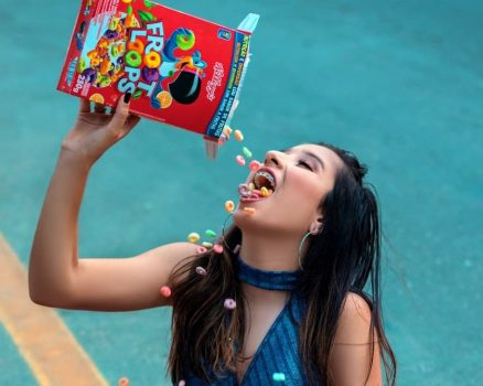 a girl pours sugary cereal all over her face